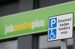 Disabled badge holder sign in front of Job Centre Plus Office, Doncaster