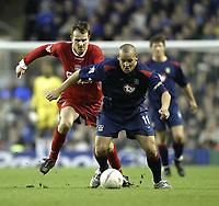 Photo. Aidan Ellis.<br />Liverpool v Portsmouth.<br />FA Cup Fifth Round.<br />15/02/2004.<br />Liverpool'sDietmar Hamann  and Pompey's Nigel Quashie
