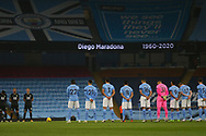 A minutes applause for Diego Maradona during the Premier League match between Manchester City and Burnley at the Etihad Stadium, Manchester, England on 28 November 2020.
