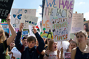 School Climate Strike, London, England, UK. A crowd of protesters hold home-made placards demanding change.
