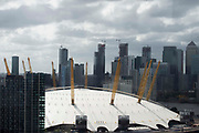 Storm clouds seen from the Emirates cable car in Greenwich hang over the O2 Arena and the financial district in  London, United Kingdom on 9th August 2019. Weather warnings of strong winds and rain have been issued for much of the United Kingdom.