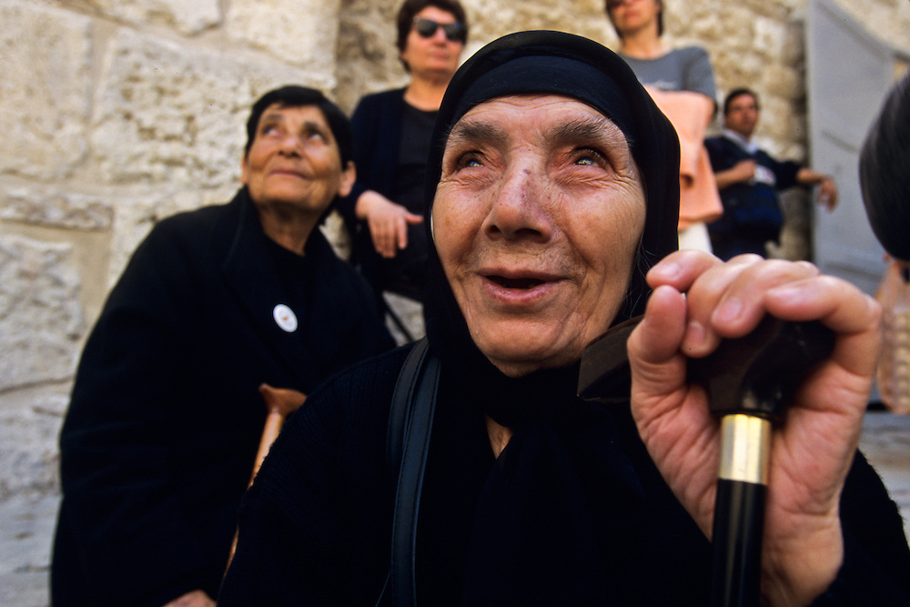 An elderly woman visiting the Holy City.