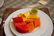 Breakfast fruit of papaya, mango and water melon at the Apsara Guest House in Luang Prabang, Laos.
