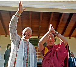 January 12, 1996 - Cape Town, South Africa - South African President NELSON MANDELA waving to the public with Buddhist Spiritual leader the DALAI LAMA, who raises his hands together to salute the crowd , as well. (Credit Image: © Sasa Kralj/JiwaFoto/ZUMAPRESS.com)