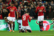 Zlatan Ibrahimovic of Manchester Utd slumps to his knees and celebrates at the final whistle.  EFL Cup Final 2017, Manchester Utd v Southampton at Wembley Stadium in London on Sunday 26th February 2017. pic by Andrew Orchard, Andrew Orchard sports photography.