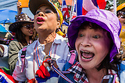 22 DECEMBER 2013 - BANGKOK, THAILAND: Anti-government protestors scream at Thai riot police guarding the home of caretaker Prime Minister Yingluck Shinawatra. Hundreds of thousands of Thais gathered in Bangkok Sunday in a series of protests against the caretaker government of Yingluck Shinawatra. The protests are a continuation of protests that started in early November and have caused the dissolution of the Pheu Thai led government of Yingluck Shinawatra. Protestors congregated at home of Yingluck and launched a series of motorcades that effectively gridlocked the city. Yingluck was not home when protestors picketed her home.     PHOTO BY JACK KURTZ