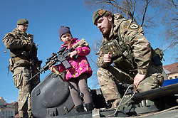 March 30, 2019 - Vilnius, Lithuania - A girl holds a machine gun during a ceremony in Vilnius, Lithuania. A number of events were held in Vilnius on Saturday to mark the 15th anniversary of the Baltic country's accession to NATO. (Credit Image: © Alfredas Pliadis/Xinhua via ZUMA Wire)