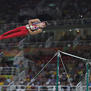 Gymnastics - Olympics: Day 3  Samuel Mikulak #195 of the United States performing his Horizontal Bar routine during the Artistic Gymnastics Men's Team Final at the Rio Olympic Arena on August 8, 2016 in Rio de Janeiro, Brazil. (Photo by Tim Clayton/Corbis via Getty Images)