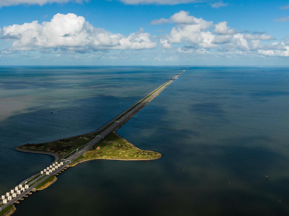 Nederland, Noord-Holland, Gemeente Wieringen, 16-04-2012; Den Oever, begin Afsluitdijk, gezien naar het noordoosten. Aan de horizon is de kust van Friesland zichtbaar. De 32 kilometer lange dijk vormt de waterkering tussen Waddenzee (links) en IJsselmeer (rechts). In de dijk de Stevinsluizen (spuisluizen of uitwateringssluizen). Het 'eiland' heet Robbenplaat. Aanleg van de dijk vormde onderdeel Zuiderzeewerken, initiatief van ingenieur Cornelis Lely..Den Oever, beginning Enclosure Dam, looking east. Frisian coast at the horizon (32 kilometers away). The dike forms the barrier between the Wadden Sea (left) and IJsselmeer lake (right). The Stevin sluices sluice surplus water to the Wadden sea. Construction of the dam was part of the Zuiderzee Works, an initiative of engineer Cornelis Lely..luchtfoto (toeslag), aerial photo (additional fee required).foto/photo Siebe Swart.luchtfoto (toeslag), aerial photo (additional fee required).foto/photo Siebe Swart