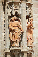 Gothic Angel statues on the Cathedral of Seville Spain . The Royal Alcázars of Seville (al-Qasr al-Muriq ) or Alcázar of Seville, is a royal palace in Seville, Spain. It was built by Castilian Christians on the site of an Abbadid Muslim alcazar, or residential fortress.The fortress was destroyed after the Christian conquest of Seville The palace is a preeminent example of Mudéjar architecture in the Iberian Peninsula but features Gothic, Renaissance and Romanesque design elements from previous stages of construction. The upper storeys of the Alcázar are still occupied by the royal family when they are in Seville. <br /> <br /> Visit our SPAIN HISTORIC PLACES PHOTO COLLECTIONS for more photos to download or buy as wall art prints https://funkystock.photoshelter.com/gallery-collection/Pictures-Images-of-Spain-Spanish-Historical-Archaeology-Sites-Museum-Antiquities/C0000EUVhLC3Nbgw <br /> .<br /> Visit our MEDIEVAL PHOTO COLLECTIONS for more   photos  to download or buy as prints https://funkystock.photoshelter.com/gallery-collection/Medieval-Middle-Ages-Historic-Places-Arcaeological-Sites-Pictures-Images-of/C0000B5ZA54_WD0s