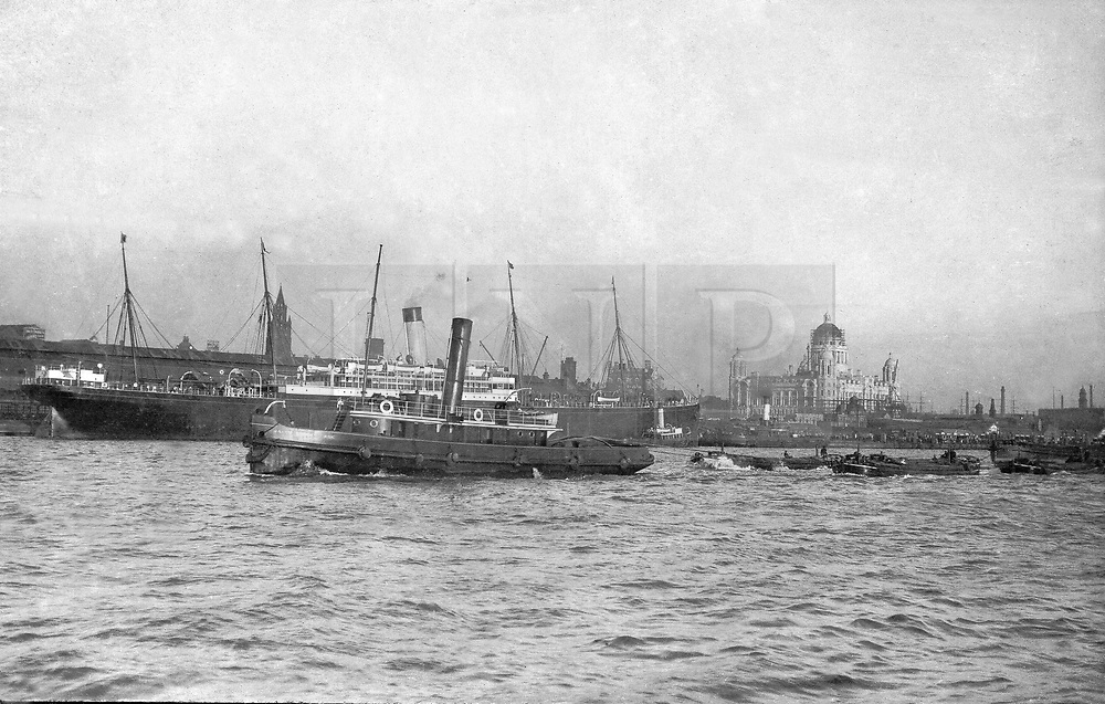 """© Licensed to London News Pictures. 30/09/2016. Birkenhead UK. Collect picture shows the Ralph Brocklebank (Daniel Adamson) passing Liverpool's Pier Head in 1907. The Daniel Adamson steam boat has been bought back to operational service after a £5M restoration. The coal fired steam tug is the last surviving steam powered tug built on the Mersey and is believed to be the oldest operational Mersey built ship in the world. The """"Danny"""" (originally named the Ralph Brocklebank) was built at Camel Laird ship yard in Birkenhead & launched in 1903. She worked the canal's & carried passengers across the Mersey & during WW1 had a stint working for the Royal Navy in Liverpool. The """"Danny"""" was refitted in the 30's in an art deco style. Withdrawn from service in 1984 by 2014 she was due for scrapping until Mersey tug skipper Dan Cross bought her for £1 and the campaign to save her was underway. Photo credit: Andrew McCaren/LNP"""