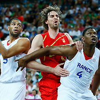 08 August 2012: Spain Pau Gasol vies for the rebound with Kevin Seraphin and Nicolas Batum during 66-59 Team Spain victory over Team France, during the men's basketball quarter-finals, at the 02 Arena, in London, Great Britain.