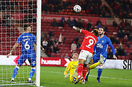 Middlesbrough forward Britt Assombalonga (9) heads his team's first goal during the The FA Cup 3rd round match between Middlesbrough and Peterborough United at the Riverside Stadium, Middlesbrough, England on 5 January 2019.