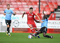 Football - 2020 / 2021 Sky Bet League Two - Crawley Town vs Southend United - The People's Pension Stadium.<br /> <br /> Crawley Town's Tyler Frost is tackled by Southend United's Elvis Bwomono.<br /> <br /> COLORSPORT/ASHLEY WESTERN