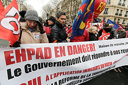 January 30, 2018 - Paris, Ile-de-France, France - People hold a banner reading 'EPHAD in danger' outside the French Ministry for Solidarity and Health in Paris on January 30, 2018 during a national day of action and strike by EHPAD (Establishment for the Housing of Elderly Dependant People) workers to demand more resources for the care of the elderly. (Credit Image: © Michel Stoupak/NurPhoto via ZUMA Press)