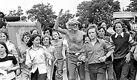 Pop idol & disc jockey Jimmy Savile heads a Safari Walk from Mallusk, Glengormley, Newtownabbey, N Ireland, to Nutt's Corner for a pop concert on 30th June 1974. 1974063000366b<br />