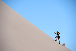 © Licensed to London News Pictures. 10/11/2014. London, England. . Photo credit : Mike King/LNP<br /> Runners train ahead of the Volcano Marathon, to be held in the Atacama Desert, Chile 11/11/2014<br /> Anne-Marie, Flammersfeld, Germany.