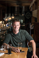 Sean Bruce, a naval officer in Victoria, BC, enjoys a beer at Canoe Brewpub as one of his favorite places. Photographed on assignment for Tourism Victoria.