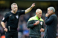 Referee Jonathan Moss sending Jose Mourinho, the Chelsea manager to the stands after Nemanja Matic of Chelsea was sent off. Barclays Premier League, West Ham Utd v Chelsea at The Boleyn Ground, Upton Park in London on Saturday 24th October 2015.<br /> pic by John Patrick Fletcher, Andrew Orchard sports photography.