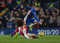 Football - 2019 / 2020 Premier League - Chelsea vs. Arsenal<br /> <br /> Matteo Guendouzi (Arsenal FC) lunges at Mason Mount (Chelsea FC) as he tries to break free with the ball at Stamford Bridge <br /> <br /> COLORSPORT/DANIEL BEARHAM