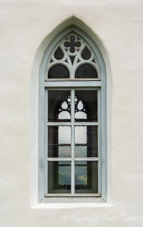 Looking through chapel windows through to the Dolomite Mountains.