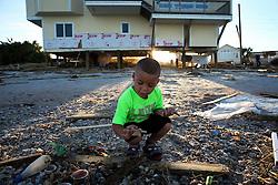 October 8, 2016 - Vilano Beach, Florida, U.S. - WILL VRAGOVIC       Times.Paxton Nieto, 5, looks for starfish in a pile of debris left on the beach by Hurricane Matthew in Vilano Beach, Fla. on Saturday, Oct. 8, 2016. (Credit Image: © Will Vragovic/Tampa Bay Times via ZUMA Wire)
