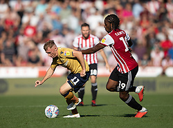 Brentford's Romaine Sawyers (right) tries to tackle Nottingham Forest's Ben Osborn