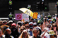 A people protesting the state government's lockdown holds a protest sign in front of a police line. The groups who have organised the many Freedom Day protest over the last 3 months, attempted to march to State Parliament on Melbourne Cup Day demanding the sacking of Premier Daniel Andrews for the lockdown and attacks on their civil liberties, where they were met with a heavy police presence.  (Photo by Michael Currie/Speed Media)
