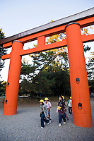 A torii is a traditional Japanese gate commonly found at the entry to a Shinto shrine.  The basic structure of a torii is two columns that are topped with a horizontal rail. Slightly below the top rail is a second horizontal rail. Torii are traditionally made from wood and are usually painted vermilion red.