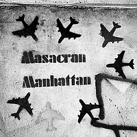 """Translation: """"MASSACRE IN MANHATTAN""""<br /> <br /> Buenos Aires, Argentina March 2006<br /> Protest, resistance and memory:  The Stencil images in Buenos Aires. <br /> The stencil art takes the streets of the Argentinian capital. Urban artists bomb in silence the city with messages that combine political and social content, imagination and irony.<br /> Photo: Ezequiel Scagnetti"""