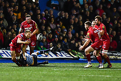 Scarlets' Tom Prydie offloads despite the tackle of Cardiff Blues' Ellis Jenkins  - Mandatory by-line: Craig Thomas/Replay images - 31/12/2017 - RUGBY - Cardiff Arms Park - Cardiff , Wales - Blues v Scarlets - Guinness Pro 14