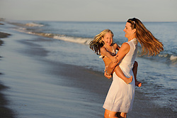 mother and daughter enjoying time together at the beach in The Hamptons