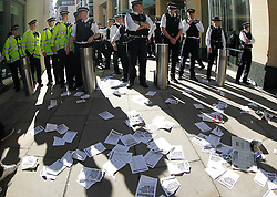 © Licensed to London News Pictures. 15/10/2011, London, UK.  Police officers prevent protesters from occupying Paternoster Square in the City of London to demonstrate outside the London Stock Exchange against corporate greed, Saturday, Oct. 15, 2011. Photo credit : Sang Tan/LNP