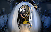 Wind Turbine Technician checks over safety gear inside the Nacelle. The image was part of editorial shoot for Real Word Safety Magazine