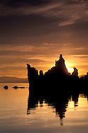 Sunrise over tufa tower and calm water, South Shore, Mono Lake, Eastern Sierra, California