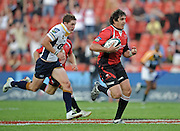 Centre of the Lions, Jaque Fourie on his way to the first try for the Lions in the Super 14 match between the Lions and the Brumbies that took place on Saturday 21 March 2009 at Coca-Cola Park in Johannesburg South Africa. The Lions won this Super 14 match against the Brumbies 25 - 17.  <br /> Photographer : Anton de Villiers / SASPA