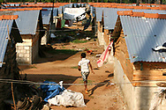 A boy makes his way through a transitional camp in Salli, in the Trincomalee District in eastern Sri Lanka, on Saturday 3rd December 2005. Tsunami victims are awaiting permanent homes to be built, after their homes were destroyed during the disaster. PRESS ASSOCIATION Photo. Photo credit should read: Chris Young/PA