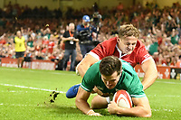 Rugby - 2019 pre-Rugby World Cup warm-up (Under Armour Summer Series) - Wales vs. Ireland<br /> <br /> Jacob Stockdale; of Ireland scores his 2nd try , at Principality (Millennium) Stadium.<br /> <br /> COLORSPORT/WINSTON BYNORTH
