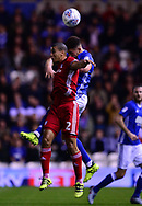 Che Adams of Birmingham and Lee Peltier of Cardiff City  battle for the ball .EFL Skybet championship match, Birmingham city v Cardiff city at St.Andrew's stadium in Birmingham, the Midlands on Friday 13th October 2017.<br /> pic by Bradley Collyer, Andrew Orchard sports photography.