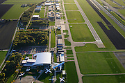 Nederland, Flevoland, Lelystad, 24-10-2013. Close-up Vliegveld Lelystad Airport met Nationaal Luchtvaart-Themapark Aviodrome.<br /> Close-up Lelystad Airport in the polder in between the farmland of the province Flevoland.<br /> luchtfoto (toeslag op standaard tarieven);<br /> aerial photo (additional fee required);<br /> copyright foto/photo Siebe Swart.