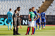 Referee Antonio Nobre throws the coin during the Liga NOS match between Belenenses SAD and Maritimo at Estadio do Jamor, Lisbon, Portugal on 17 April 2021.