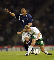 Photo Aidan Ellis.<br /> Scotland v Slovenia.<br /> 2006 FIFA World Cup Qualifier.<br /> Hampden Park Glasgow.<br /> 08/09/2004.<br /> Scotland's Nigel Quashie battles with Slovenia's Jalen Pokorn<br /> <br /> NORWAY ONLY