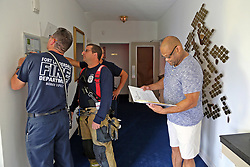 Fort Lauderdale firefighters, from left, Jorge Moral, Capt. Matt Adams and Matthew Modafferri help reset the fire alarm at Sunshine Cathedral with Executive Minister Robert Griffin in Fort Lauderdale, FL, USA on Monday, September 11, 2017, after Hurricane Irma blew through South Florida. Photo by Amy Beth Bennett/Sun Sentinel/TNS/ABACAPRESS.COM