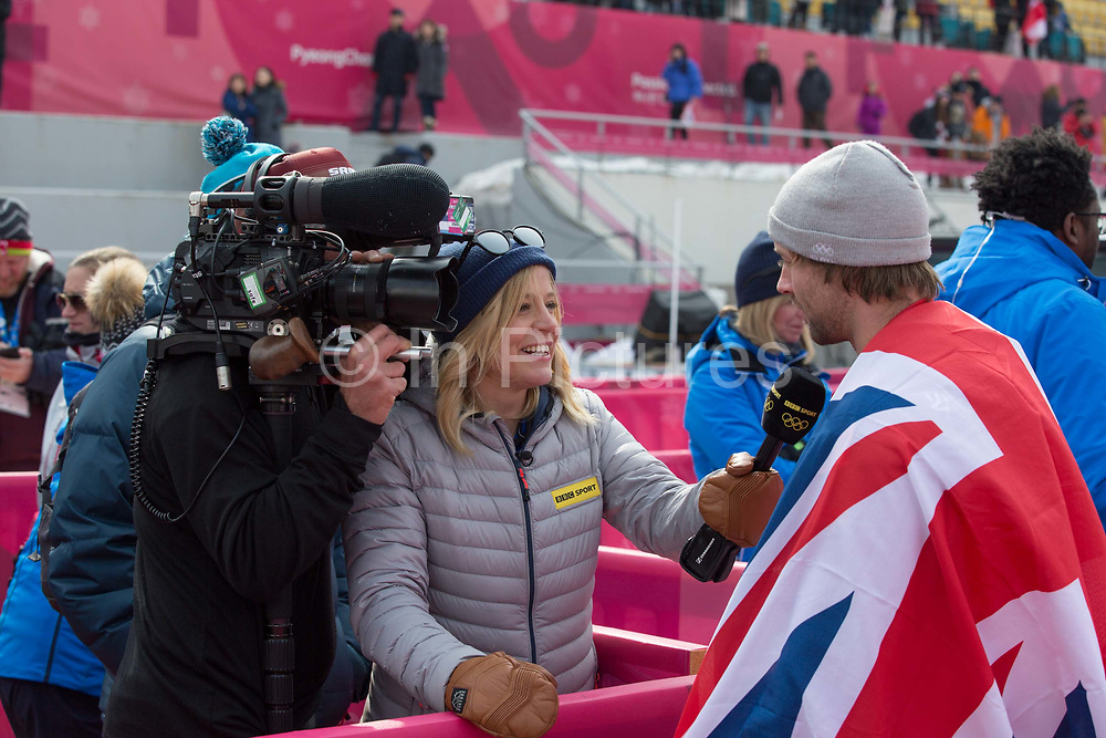 Sochi Bronze medalist Jenny Jones interviews Billy Morgan, Great Britain, BRONZE for the BBC following the mens snowboard big air flower ceremony at the Pyeongchang 2018 Winter Olympics on 24th February 2018, at the Alpensia Ski Jumping Centre in Pyeongchang-gun, South Korea