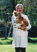 Dr. William Dement, MD and Ph.D at Standford University in California, holding Tucker, seen normal moments before cataplexy attack. Dr. Dement is a pioneer in the study of sleep and dreams.