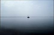 Nederland, Zeeland, 22-8-2003Een vissersboot tijdens een warme windstille avond op het Veerse meer. Water, landschap, rust, associatieFoto: Flip Franssen/Hollandse Hoogte