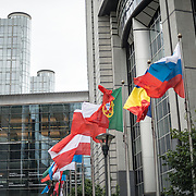 Flags flying in front of the European Parliament Building in Brussels, Belgium.