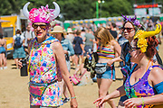 The sun beats down on the arena leading to all sorts of methods of protecting heads from it - The 2018 Latitude Festival, Henham Park. Suffolk 14 July 2018