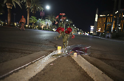 LAS VEGAS, Oct. 3, 2017  Flowers and candles are placed near the site of a mass shooting in Las Vegas, the United States, on Oct. 2, 2017. At least 59 people were killed and 527 others wounded after a gunman opened fire Sunday on a concert in Las Vegas in the U.S. state of Nevada, the deadliest mass shooting in modern U.S. history.  zy) (Credit Image: © Wang Ying/Xinhua via ZUMA Wire)