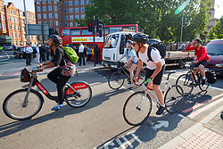 © Licensed to London News Pictures. 09/07/2015. London, UK. People commuting on their bikes outside Waterloo Station as tube strike shuts down the entire London Underground network on Thursday, July 9, 2015. The strike called by RMT, TSSA and Unite unions is a 27-hour stoppage by about 20,000 Tube staff and shuts down the entire London Underground network. Photo credit: Tolga Akmen/LNP